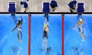 Simone Manuel, left and Penny Olkeksiak, right, touch the wall together to tie and both win gold medals.