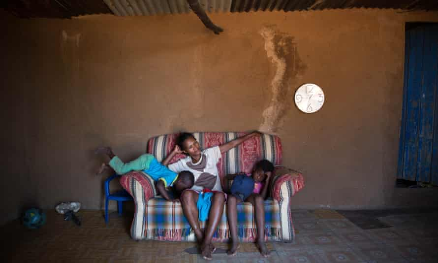 Sibongile Sibeko with her children Linda, four, left, and Jabulile, eight, right. The Sibeko family live on the edge of the coal mine in Arbor.