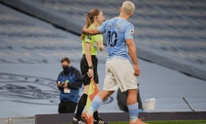 Sergio Agüero puts his hand on the assistant referee Sian Massey-Ellis during Manchester City's 1-0 victory against Arsenal on Saturday.