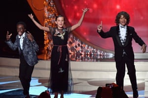 Actors from Stranger Things Caleb McLaughlin, Millie Bobby Brown and Gaten Matarazzo perform onstage during the Emmys