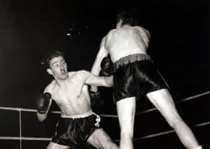 Ronnie Kray (left) during a lightweight fight that he lost on points to Bill Sliney in December 1951. Also appearing on the same bill was Ronnie's twin brother Reggie and their elder brother Charlie.
