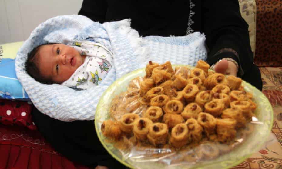 A mother with her newborn son in Gaza