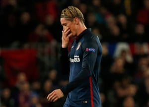 Fernando Torres walks off the pitch after receiving a red card.