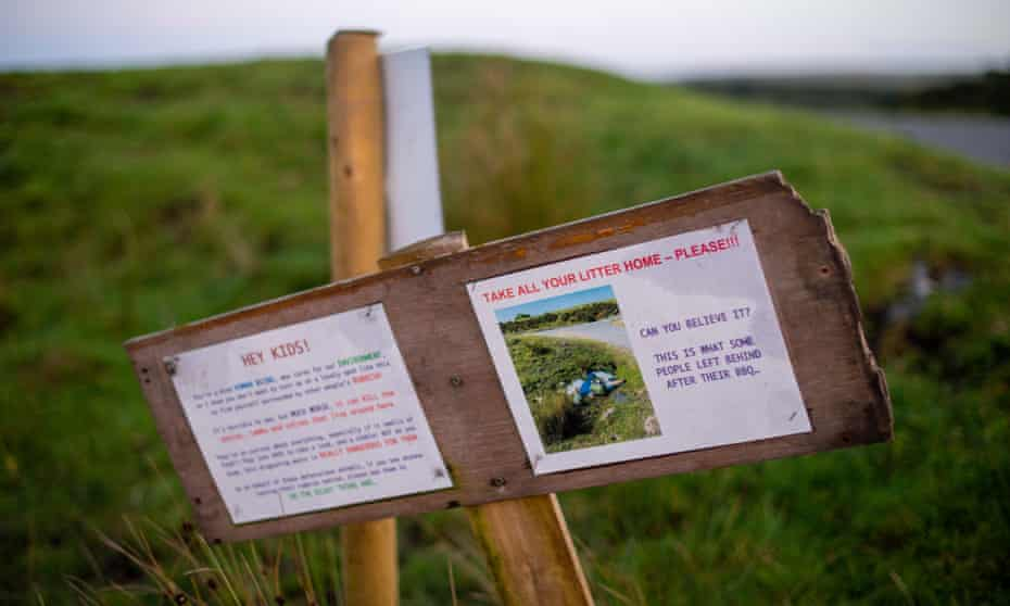 Sign warning visitors to take litter home