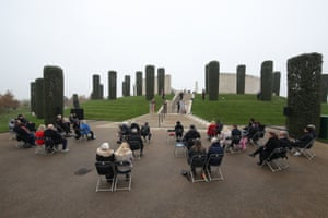 Pre-booked visitors at the National Memorial Arboretum in Alrewas, Staffordshire, observe the 'virtual' act of remembrance from the Armed Forces Memorial, which is being broadcast online during Remembrance Sunday