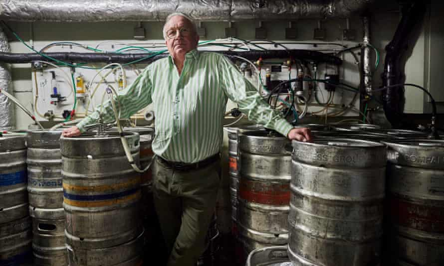 Steven Rowlands, landlord of the Tipperary, surrounded by kegs full of Guinness and other drinks.
