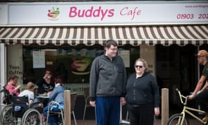 Couple Margaret and George outside Buddys Cafe where they met
