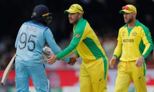 Australia's Aaron Finch commiserates with England's Adil Rashid.