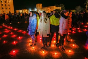 People light candles near a memorial in Kiev for so-called liquidators who died during cleanup effort after the Chernobyl disaster