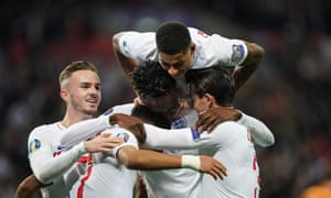 Tammy Abraham celebrates his England goal with James Maddison, Jadon Sancho, Marcus Rashford and Ben Chilwell.