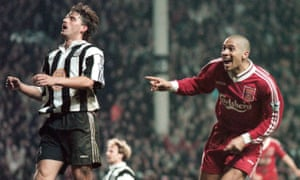 Stan Collymore celebrates after scoring Liverpool's winning goal on an extraordinary night at Anfield, to the despair of Newcastle's Philippe Albert.