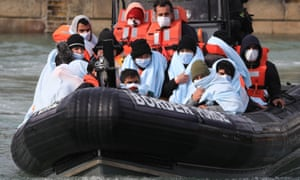A group of people on a Border Force dinghy.