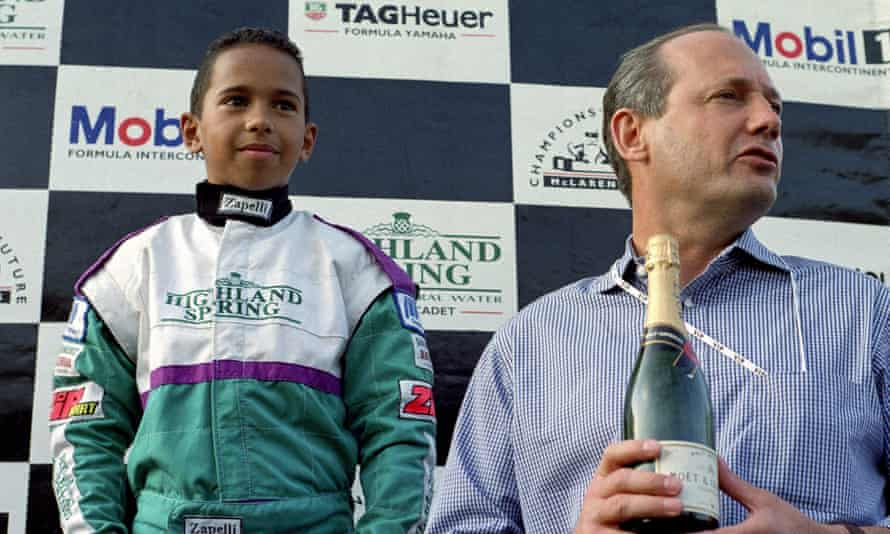 Lewis Hamilton winning a karting race in 1996, on the podium with McLaren boss Ron Dennis.