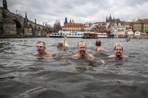 Prague, Czech Republic. The 'Three kings' swim in the Vltava River in freezing temperatures