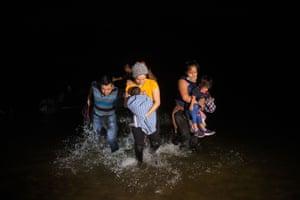 Asylum seekers cross the Rio Grande River from Mexico into Roma.