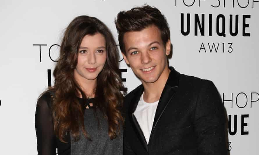 Story of his life: Louis Tomlinson with partner Eleanor Calder in 2013.