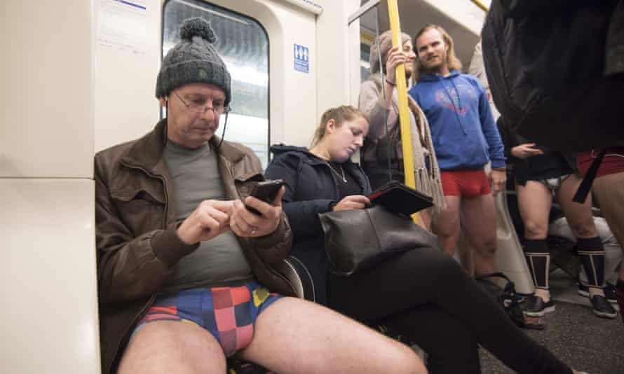 Travellers in London get into the spirit of the no pants ride on Sunday.