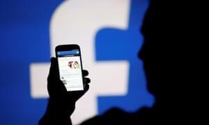 Facebook logo and smartphone