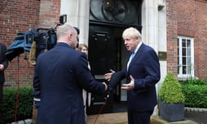 Boris Johnson speaking to reporters as he arrived at Stormont House this morning.