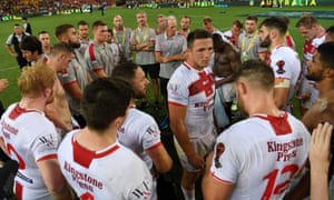 England's Sam Burgess speaks to his team after the final.