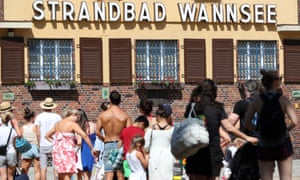 People queue at the entrance to the open-air lido in Berlin