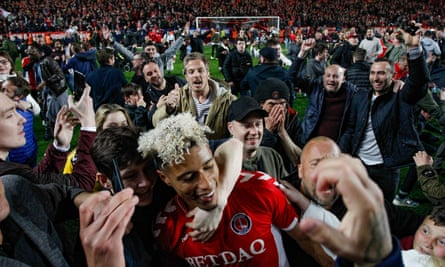 Charlton's Lyle Taylor is mobbed on the pitch after their dramatic win over Doncaster on penalties.