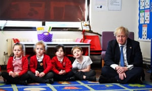 Boris Johnson sits with Year 1 pupils from the Stingray class during a visit to St Leonard's Church of England Primary Academy in Hastings.