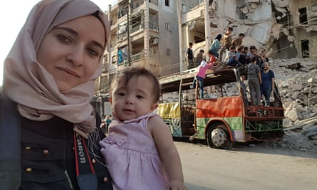 Al-Kateab and her daughter, Sama, in Aleppo in 2016.