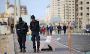 Police patrol the Gaza city seafront to enforce the territory's coronavirus restrictions