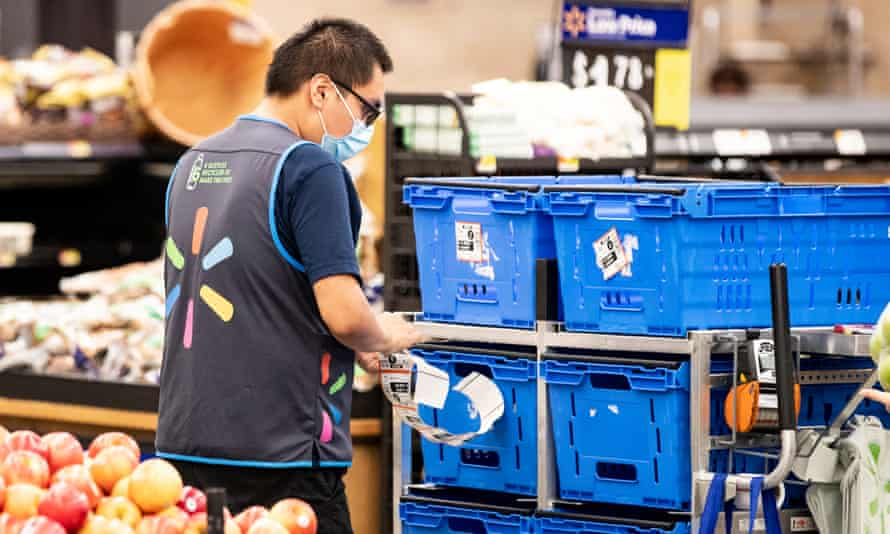 A Walmart employee wears a mask at a store in Burbank, California.