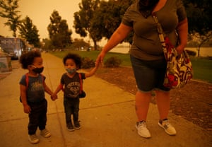 Emory and Henry Peters walk with their nanny Cynthia Chavez at Lake Merritt in Oakland.