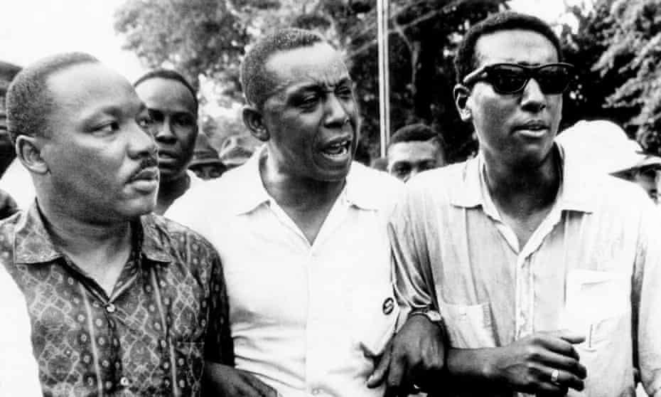 American civil rights activists Martin Luther King, Floyd McKissick and Stokely Carmichael in Canton, Mississippi.