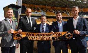 Wolves' manager Nuno Espirito Santo, second left, is a Jorge Mendes client. The club's managing director, Laurie Dalrymple, far right, said the agent's role was advisory: 'Someone, because of the friendship with the owners, that we take opinions and advice from.'