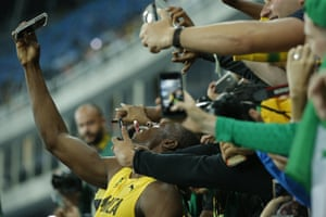 Usain Bolt, ever the crowd pleaser, takes selfies with his fans.
