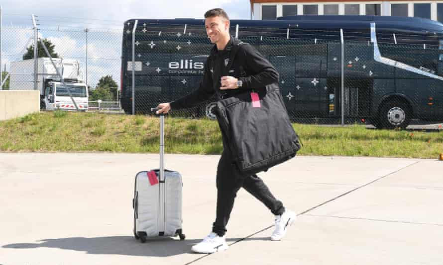 Laurent Koscielny prepares to board the flight taking Arsenal to Baku for the Europa League final.