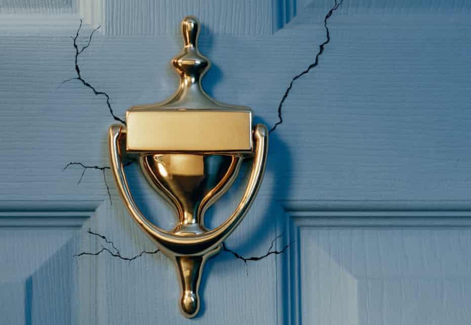 Brass door knocker on front door, close-up