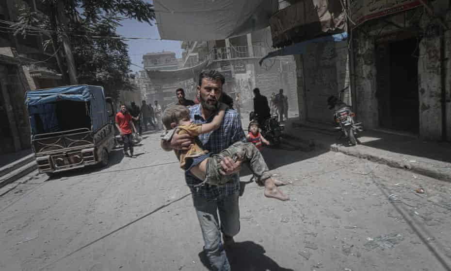 Civilians flee an airstrike in Idlib