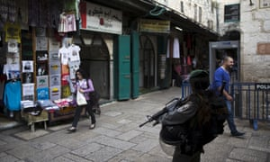 An Israeli border policewoman stands guard in Jerusalem's old city.