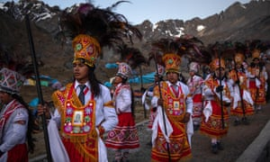 Costumed dancers parade during the annual Qoyllur Rit'i festival in Ocongate, Peru, in May 2018. Peru is home to 55 indigenous peoples, speaking dozens of languages.