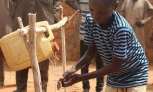 Sirajo Barawu,12, uses the hand-washing facility in Yammawar Kafawa.