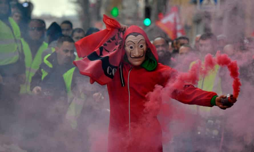 A demonstrator wears the red jumpsuit and Dali mask from the show during an anti-government protest in France.
