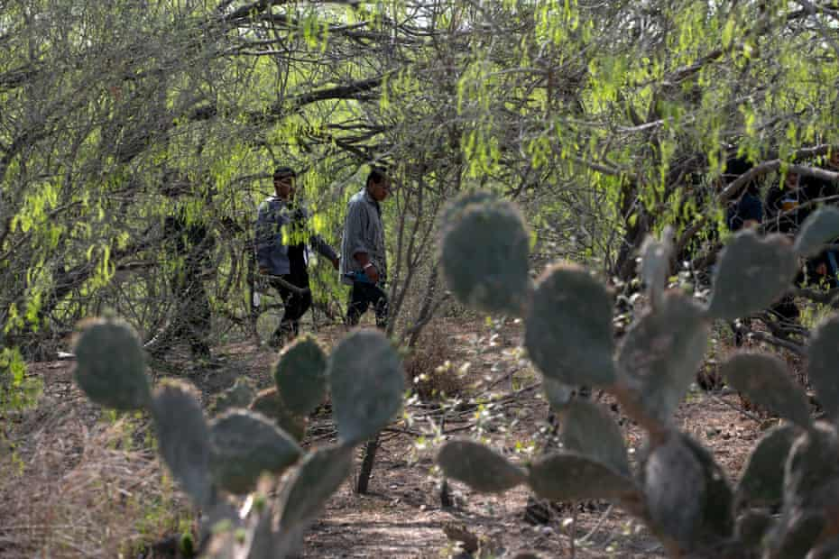 Central American migrants are detained by border patrol while crossing through the Rio Grande Valley, Texas.