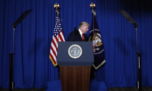 Donald Trump walks from the podium at Mar-a-Lago