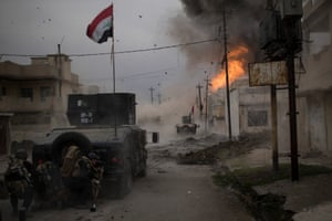 A car bomb explodes next to Iraqi special forces armoured vehicles as they advance towards Isis-held territory in Mosul.