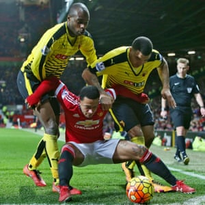 Memphis Depay uses all his strength to hold off Watford's Allan Nyom and Troy Deeney at Old Trafford
