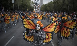 Women dressed as monarch butterflies perform during the Day of the Dead Parade in Mexico City on 27 October 2019 in Mexico City.