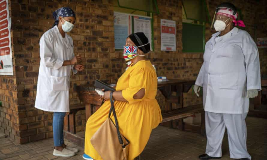 A South African woman is briefed before taking a Covid-19 test in Groblersdal, north-east of Johannesburg.
