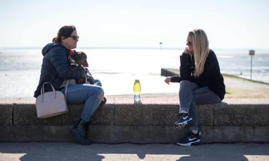 Two friends meet by Chalkwell beach, Southend-on-Sea, March 2021.
