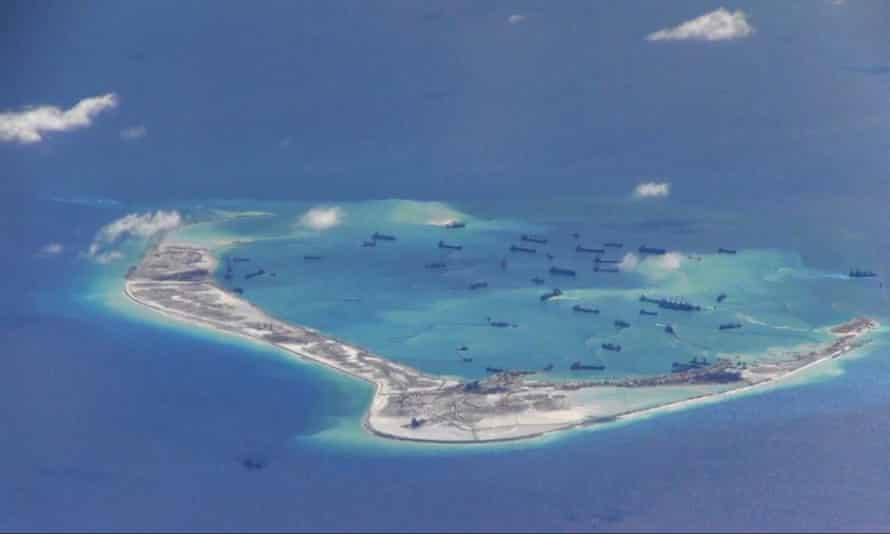 Chinese dredging vessels in the waters around Mischief Reef in the South China Sea.