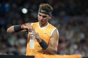 Rafael Nadal rehydrates at the 2019 Australian Open.